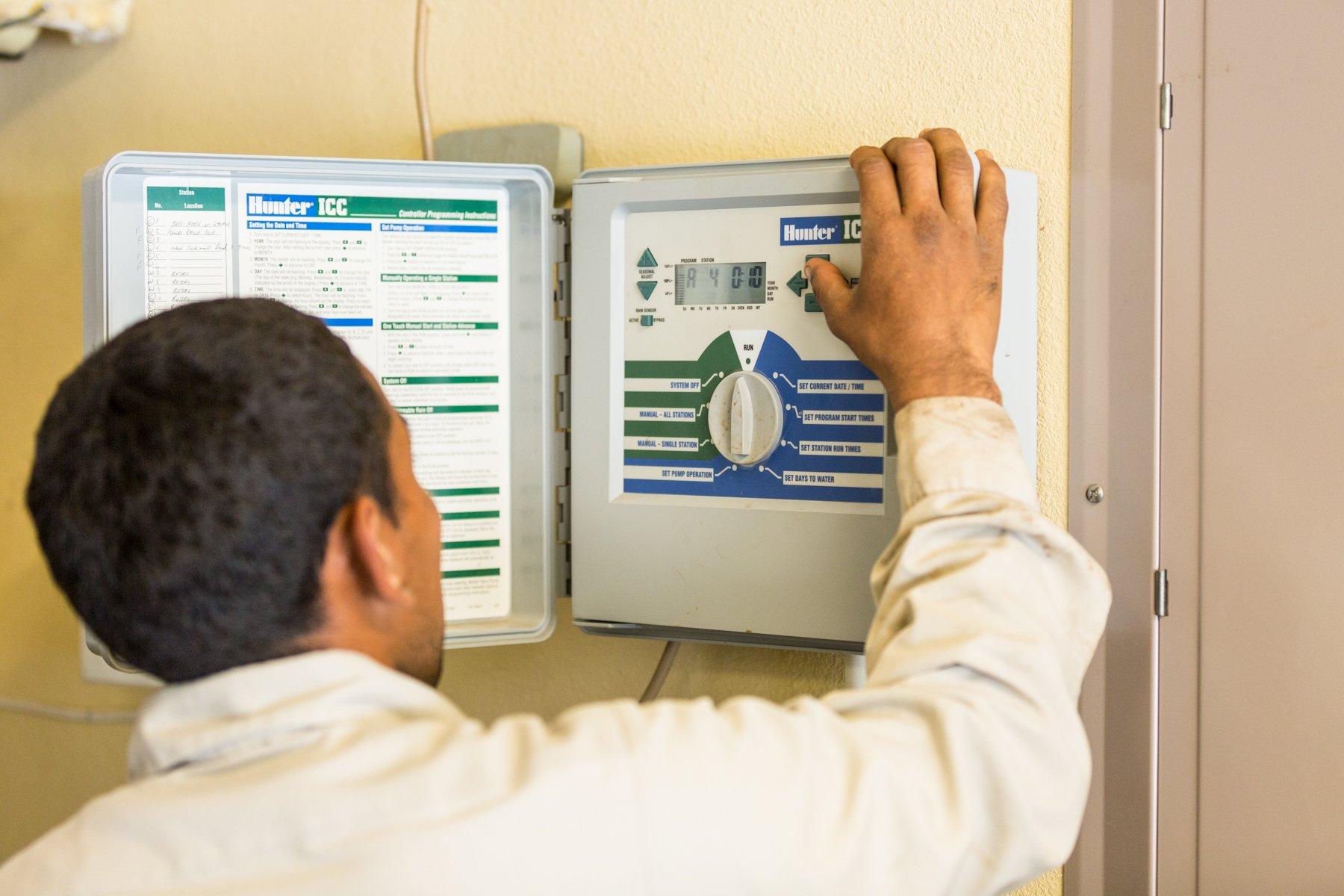 irrigation technician adjusting controls for spring start-up
