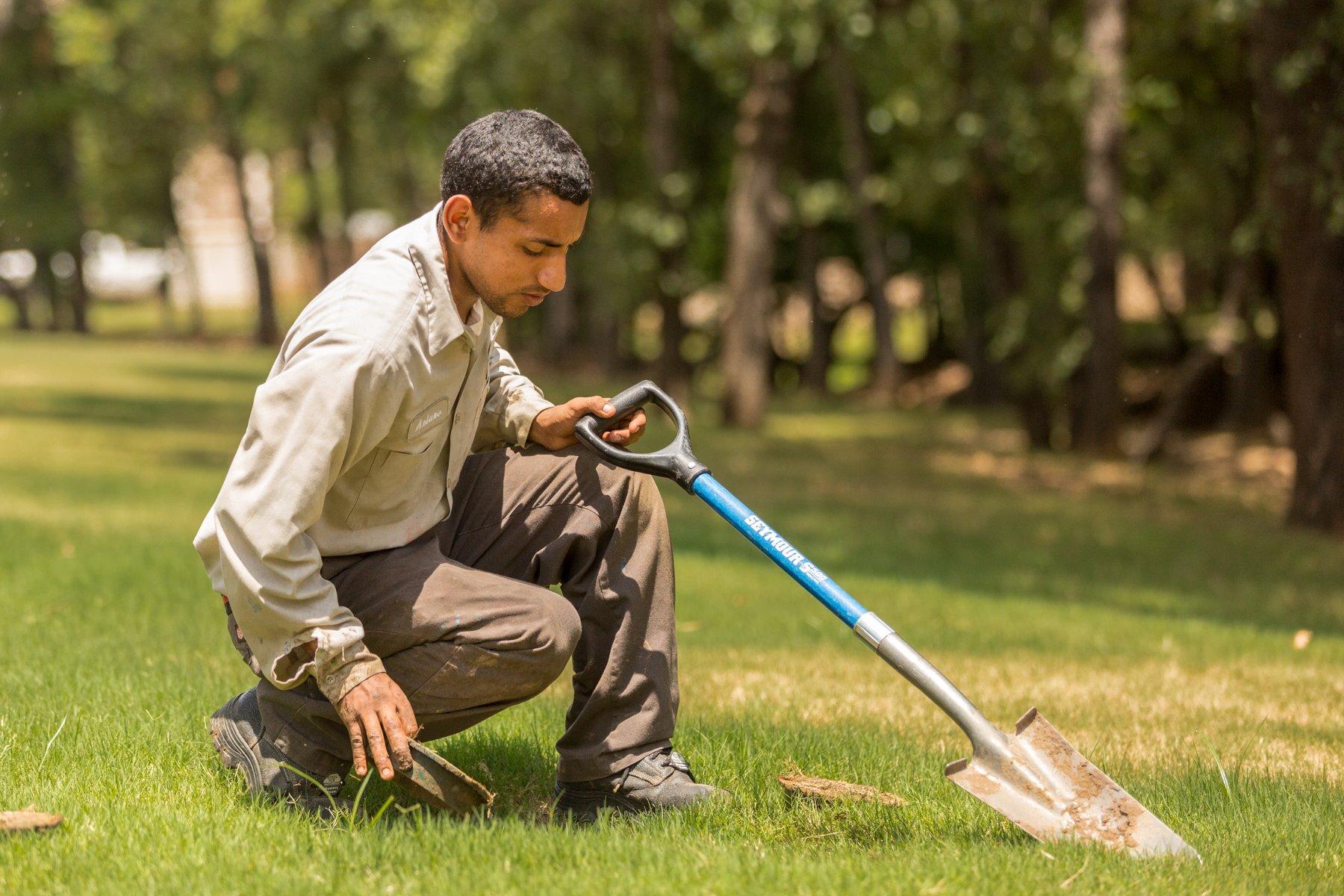 Grassperson team inspecting a customers irrigation system