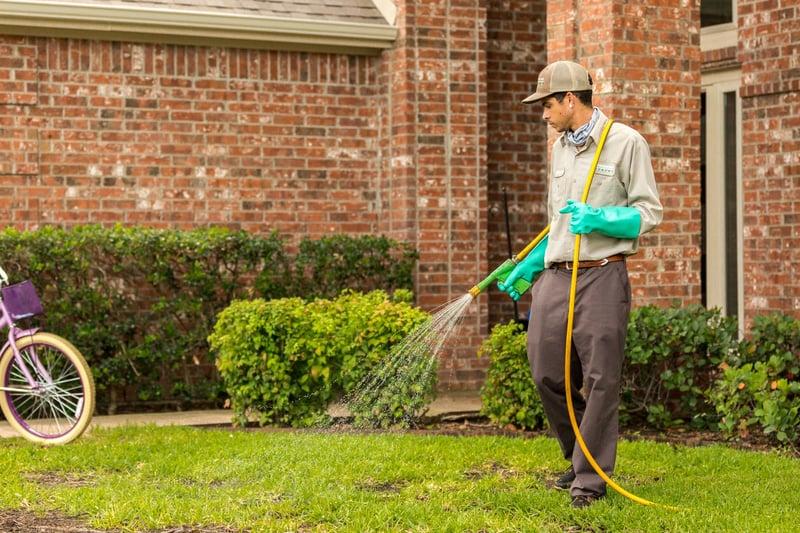 lawn technician spraying 456