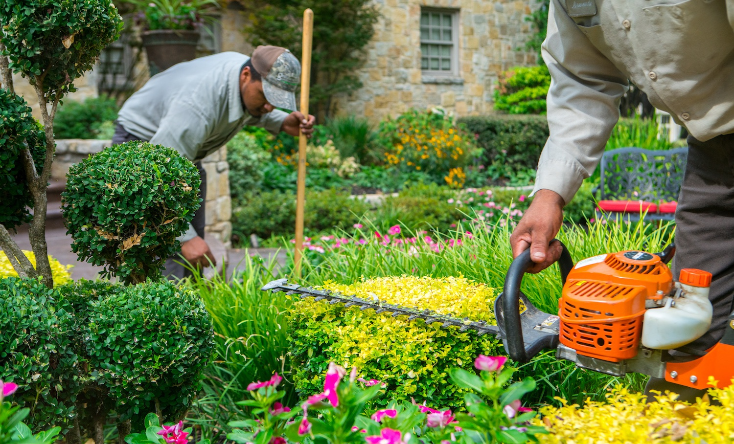 technicians performing landscaping job in Texas