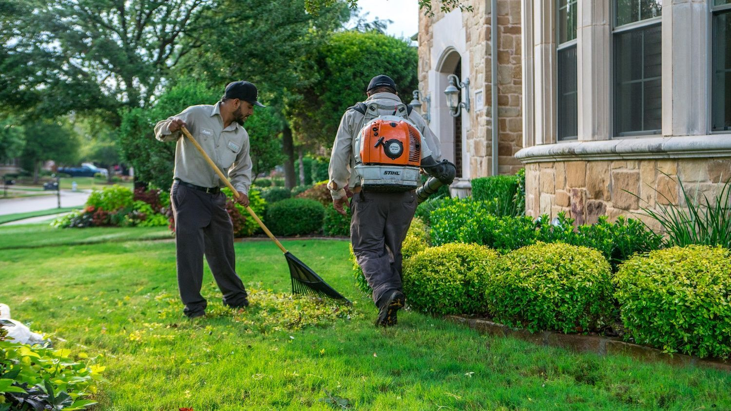 landscape technicians performing fall cleanup