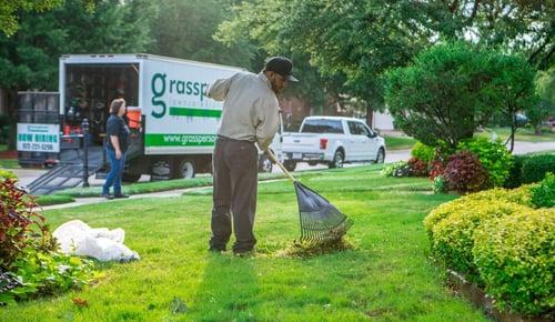 grassperson-crew-lawn-maintenance-leaf-raking-truck-2