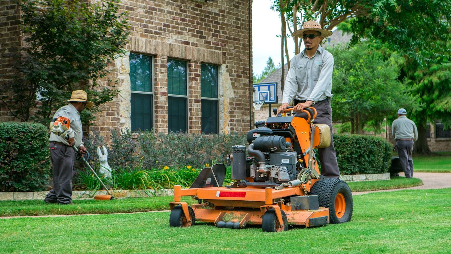 landscape field workers maintaining lawn in Texas