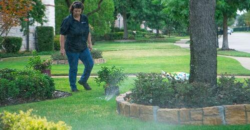 grassperson-crew-lawn-maintenance-sprinkler-irrigation-2