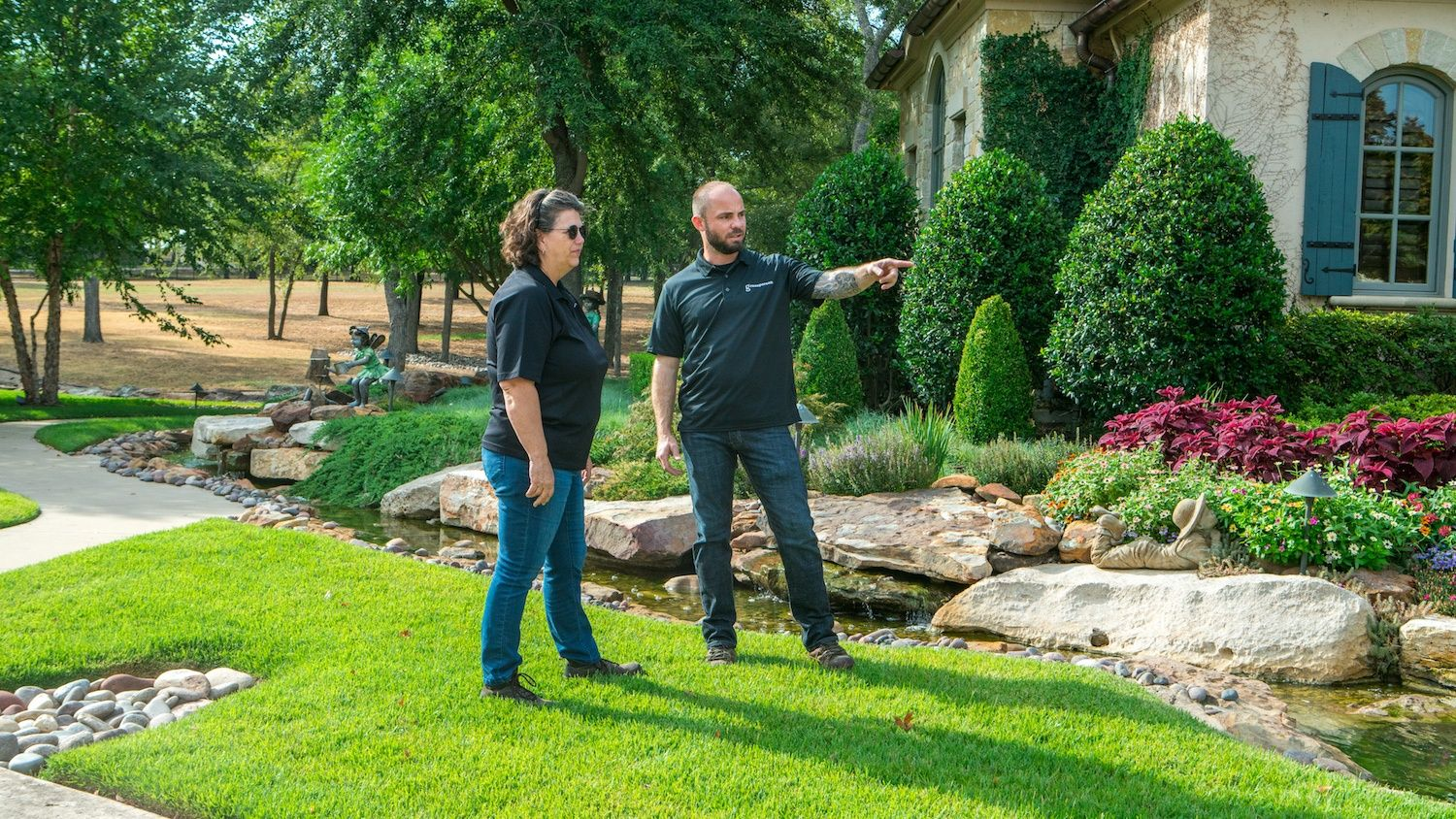 Lawn Care professionals assessing customer lawn