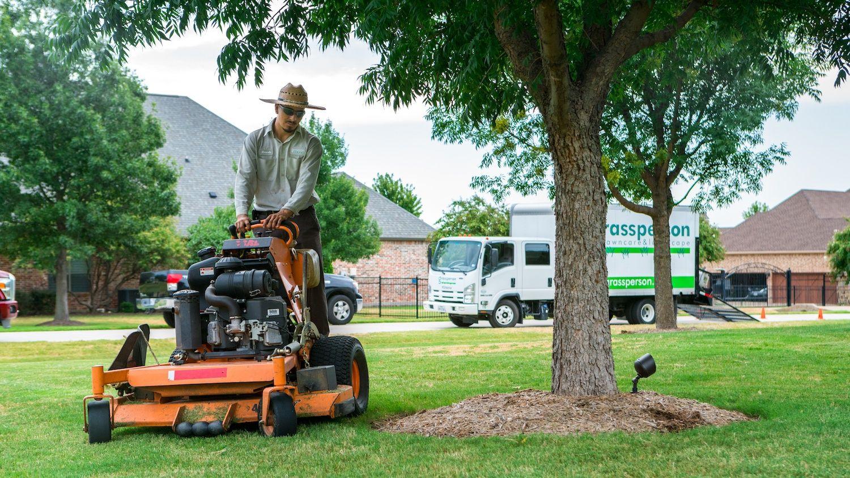 grassperson-crew-mowing-truck