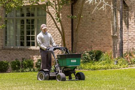 worker performing lawn care services