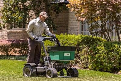 lawn care services spreading fertilizer in Flower Mound, TX