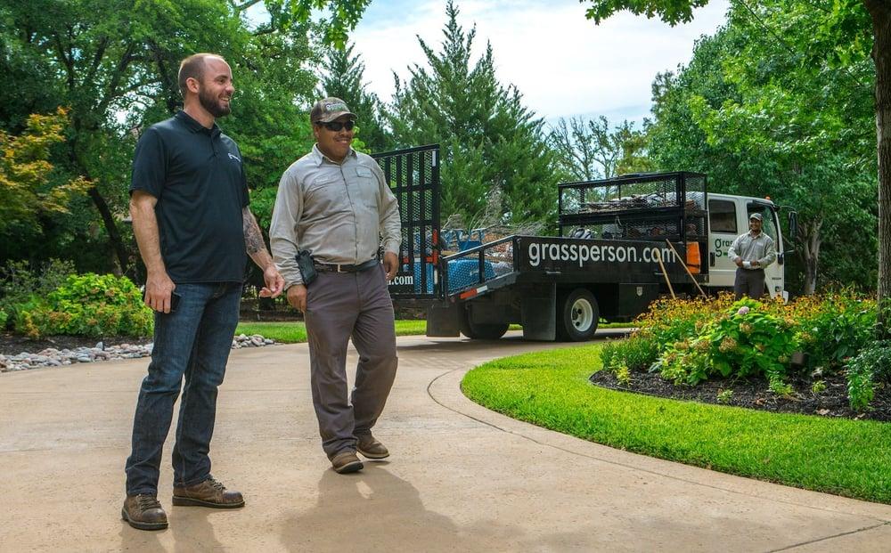 grassperson-crew-truck-driveway