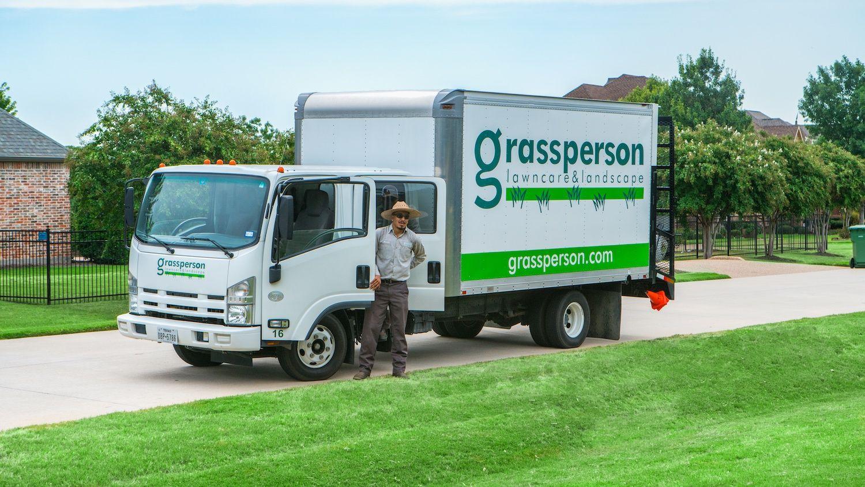 Grassperson lawn care service truck at Flower Mound, TX lawn