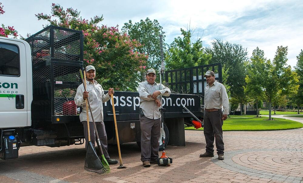 grassperson-crew-truck-tools-driveway