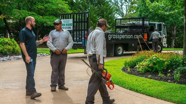 grassperson-crew-truck-trimmer-driveway