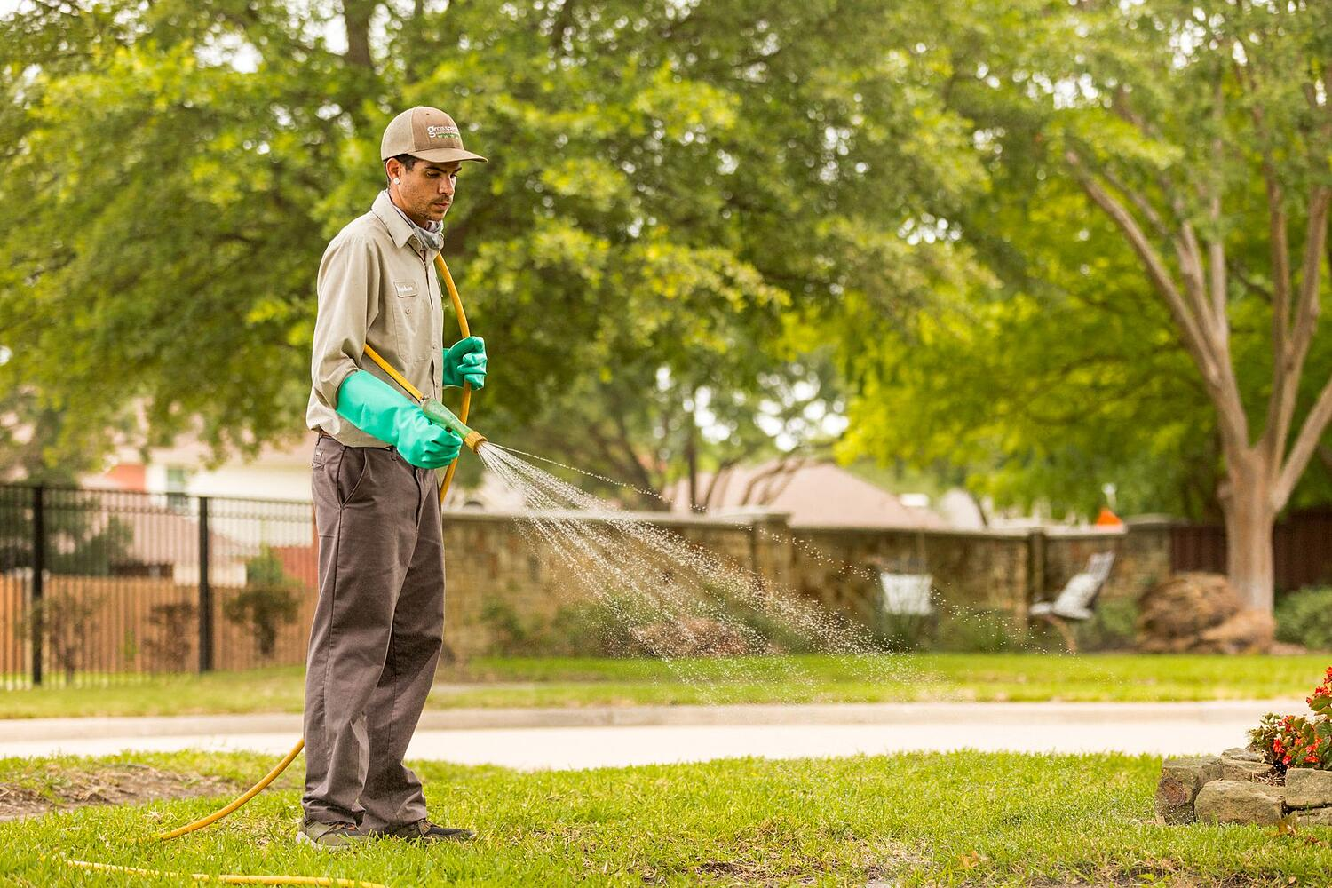 lawn care technician applying weed control in north Texas