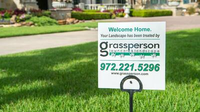grassperson lawn care and landscaping sign in lawn in Flower Mound, TX
