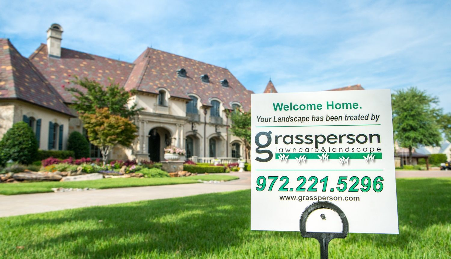 Grassperson Lawn Care & Landscape sign in lawn in Flower Mound, TX