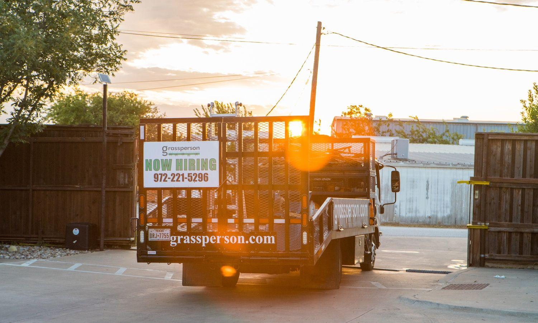 Grassperson truck with Now Hiring sign in Lewisville, TX
