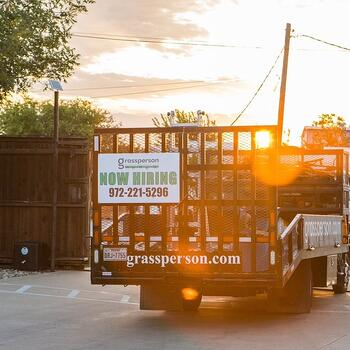 Grassperson Lawn Care & Landscape truck with now hiring sign