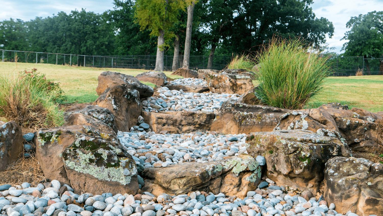 walkway-stones-rocks-pebbles-plants-lawn