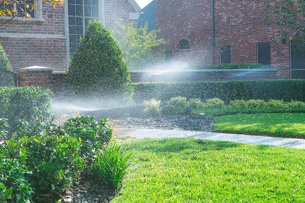 irrigation sprinklers spraying lawn