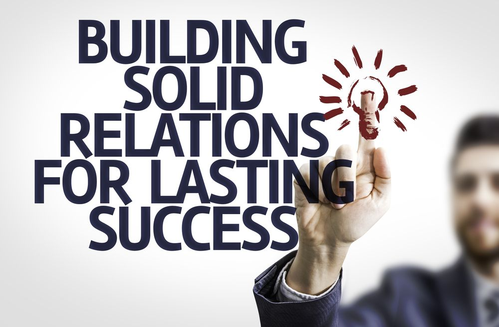 """Customer service sign stating """"building solid relations for lasting success"""""""
