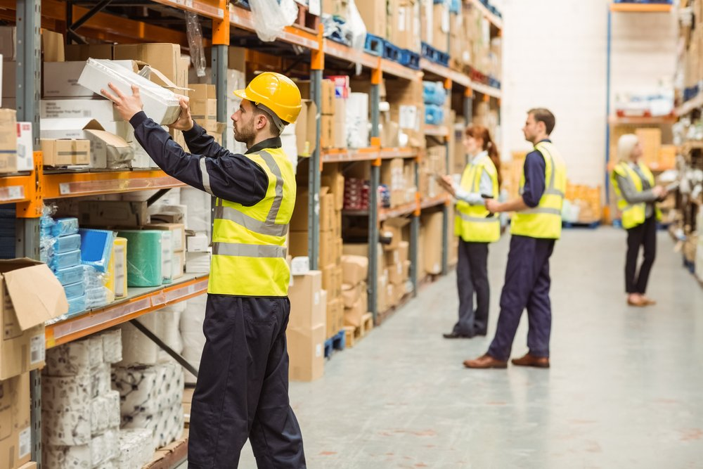Warehouse workers sorting packages